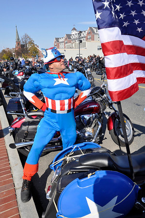 Salem:  Many riders came dressed in costume, with Bert Diorio of Revere as Captain America.  photo by Mark Teiwes / Salem News