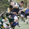 Danvers: St. John's Prep rugby player Donald Pasquarello gets slowed down by a Bishop Hendricken player after gaining yardage.  photo by Mark Teiwes / Salem News