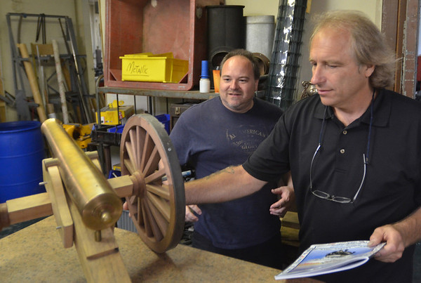 Danvers:  Machinist Dana Migneault, left, and Ed Jordan also pursue hobbies such as making canons and restoring classic cars.  photo by Mark Teiwes / Salem News