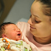 Beverly: Yolinnet Colon holds her newborn son Jeremiah Joel Nival at Beverly Hospital.  photo by Mark Teiwes  / Salem News