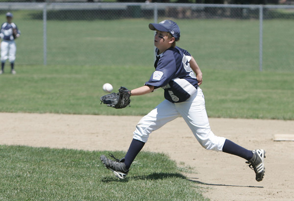 Danvers: Hamilton-Wenham's Nick Cutler makes a stop in a District 15 Little League all-star game against Amesbury.   photo by Mark Teiwes / Salem News