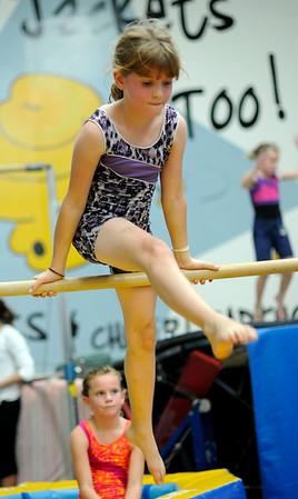 Danvers: Ashley Batakis, 9, practices on the bar at Yellow Jacket gymnastics practice.