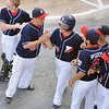 Lynn: The Peabody West little league all star team celebrates with Nick Palmer, center, after he hit a home run against Peabody American.   photo by Mark Teiwes  / Salem News