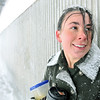 Salem: Jen Hale of Salem waits for a train delayed due to the weather on her way to go to work at Verizon Wireless in Cambridge.  She has to close the store at 9pm.  photo by Mark Teiwes / Salem News