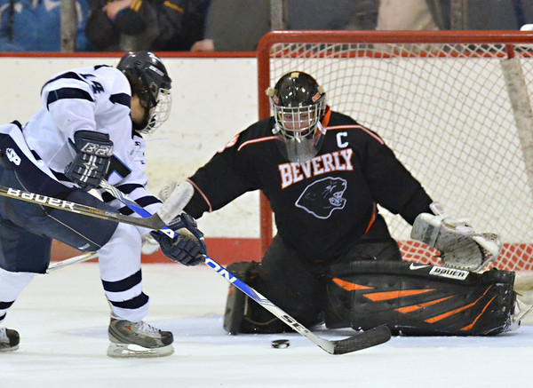 Salem:  Peabody's Eric Costa gets a look on goal covered by Beverly's   Tony Walsh.  photo by Mark Teiwes / Salem News