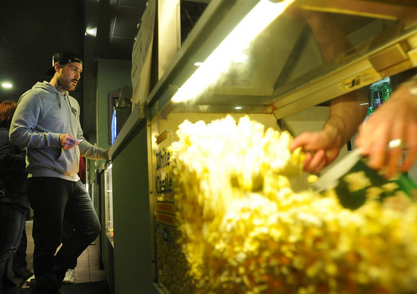 Salem: Jeff Gardner waits for some popcorn at Cinema Salem ready to watch a Lost episode on the big screen. photo by Mark Teiwes / Salem News