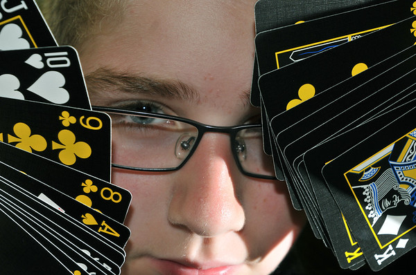 Peabody:  Derek DuBois of Everett, 12, holds his magic deck of cards.  photo by Mark Teiwes / Salem News
