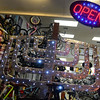 Salem: Dan Shuman, the owner of  Salem Cycle, made a 5-foot  menorah from a cardboard bike box and foil displayed in the store's window. photo by Mark Teiwes / Salem News