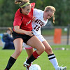 Beverly: Salem captain Holbrook Phelan, shields the ball from Beverly captain Sky Cowans.  photo by Mark Teiwes  / Salem News