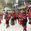 North Billerica:  Alex Whitemore, right, and the Marblehead High School hockey celebrate their Division 3 North championship crushing top seeded Shawsheen 6-2 to advance to Div. 3 state semis.  photo by Mark Teiwes / Salem News