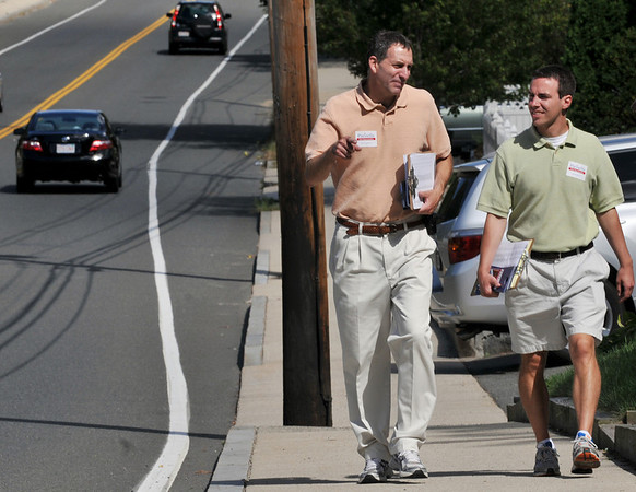 Beverly: State Representative candidate Jerry Parisella, left, and volunteer John Paul Besse campaign door to door along Elliot Street in Beverly.  photo by Mark Teiwes / Salem News