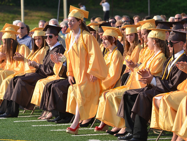 Peabody:  Salutatorian Stephanie Haddad rises to speak at  graduation remembering her years at Bishop Fenwick High School.  photo by Mark Teiwes / Salem News
