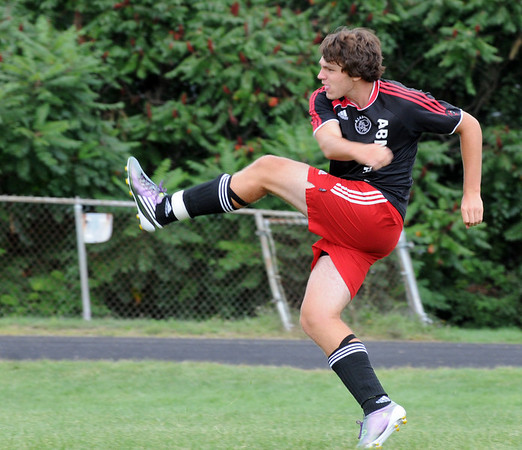 Marblehead:  Marblehead boys soccer team captain Mike Brenan follows through after a shot during practice.  photo by Mark Teiwes / Salem News