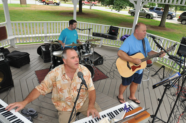 Topsfield: Tim Hart, left, J.D. Foster, and Joe Macey play classic rock hits on Topsfield Common.  photo by Mark Teiwes / Salem News