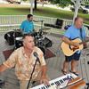 Topsfield: Tim Hart, left, J.D. Foster, and Joe Macey play classic rock hits on Topsfield Common.  photo by Mark Teiwes / Salem News
