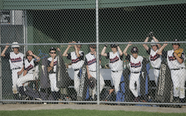 Lynn: The Swampscott all star team watches their teammate at bat in a 16 little league game. photo by Mark Teiwes / Salem News