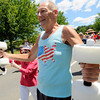 Peabody: John Wroblewski does calisthenics while parading with the health club for Brooksby Village residents. photo by Mark Teiwes / Salem News