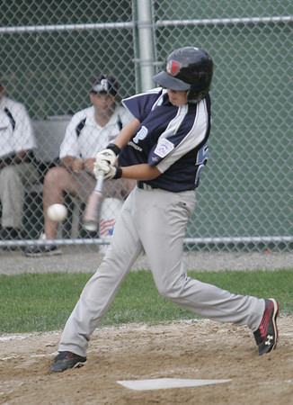 Lynn: Peabody American's Cam Eon takes a swing at bat in a district 16 little league game. photo by Mark Teiwes / Salem News