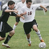 Beverly: Beverly's Mike Rosenberry, right, dribbles the ball followed by Ipswich's Sean Whooley.   photo by Mark Teiwes  / Salem News