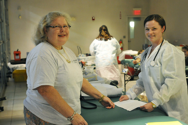 Danvers: From left, Cynthea Michaels of Beverly and Melanie Chapman, Red Cross Team Supervisor.   photo by Mark Teiwes / Salem News