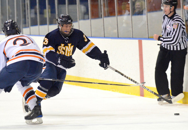Salem: University of Southern Maine's Matt MacDonald, former Pingree player is defended by Salem State's Kyle Phelan. photo by Mark Teiwes / Salem News