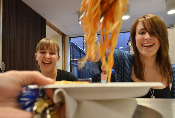 Peabody: Peabody High School sophmores, Kaylee Brazell, left, and Kim Sosa serve up spaghetti during a fundraiser for the senior class. photo by Mark Teiwes / Salem News