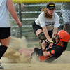 Beverly: Beverly's Courtney Brennan slides safe into 3rd base covered by Bishop Fenwick's Kim Shinnick. photo by Mark Teiwes / Salem News