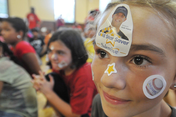 Salem:  Miranda Graves, 9, shows off her fan pride for Red Sox second baseman Dustin Pedroia at his visit to the Boys & Girls Club of Greater Salem.  photo by Mark Teiwes / Salem News