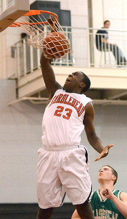 Marblehead: Marblehead's Malik Abu dunks over Lynn Classical's Nick Grassa. photo by Mark Teiwes / Salem News