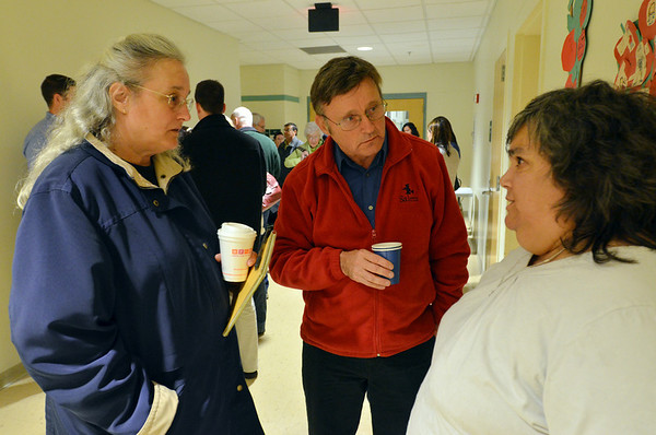 SALEM: Hedy Thibailt, left, speaks with Tom Furey, city councilor, and Helaine Berg about the methadone clinic.  photo by Mark Teiwes / Salem News
