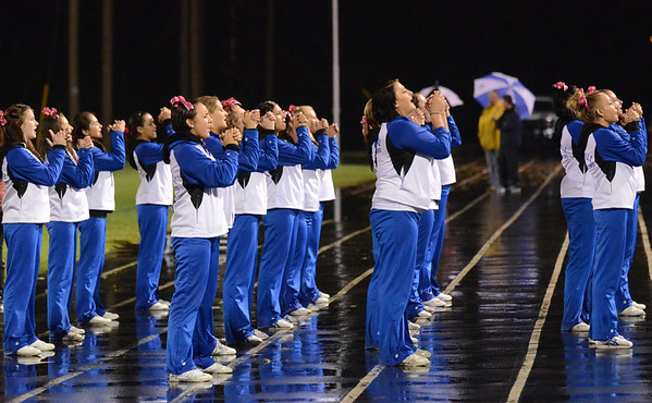 Danvers: Danvers High School cheerleaders clap in formation during Friday night's game against Pentucket.  photo by Mark Teiwes / Salem News