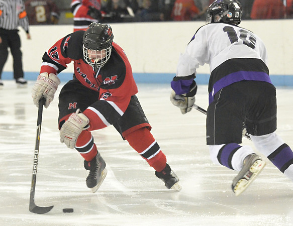 North Billerica: Marblehead captain Ryan Dempsey eludes Shawsheen defender Steven Simas on his way to the gaol..    photo by Mark Teiwes / Salem News