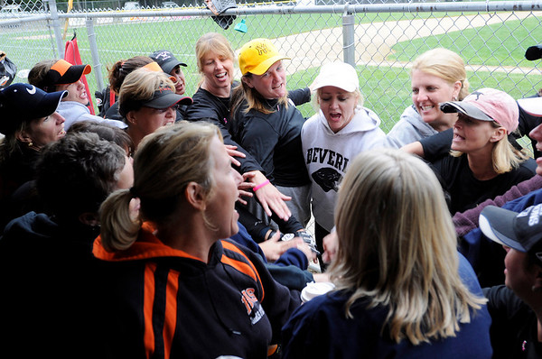 Beverly: A team made from moms of Beverly High School students cheer before a championship game against Cove School moms.  photo by Mark Teiwes / Salem News