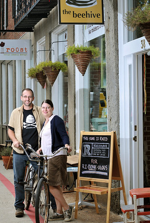 Salem: Husband and wife Jamie Metsch and Kate Leavy have two Front Street businesses side by side, Roost and Beehive.  The couple rides a tandem bike to work.  photo by Mark Teiwes / Salem News