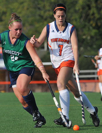 Salem: Salem State's Nicole Bisbee, right pushes the ball upfield defended by Endicott's Robin Hunt. photo by Mark Teiwes / Salem News