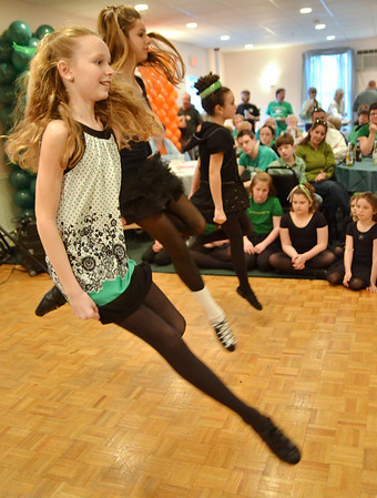 Salem: Naimh Dalton, left, and her sisters Aisling Batchelder, and Aoife Dalton of Manchester Irish step dance at the Salem AOH on St. Patrick's Day.  photo by Mark Teiwes / Salem News