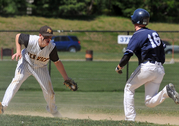 Peabody: After fielding a ground ball, Bishop Fenwick 2nd baseman Mike Davis is ready to tag out a St. John's runner. photo by Mark Teiwes / Salem News