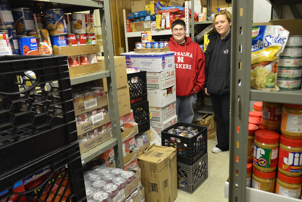 Peabody: Luz Davidson, left, and Carlie DeStafano, both from Peabody, are volunteers at Haven from Hunger helping with various tasks including stocking shelves with food.  photo by Mark Teiwes  / Salem News