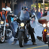 Salem:  A few riders show off with a tire burnout as the Halloween Witch Ride comes to an end on Congress St. photo by Mark Teiwes / Salem News