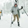 Salem: Ellen Gallagher, right, and her husband Steven cross country ski through the Salem Commons as a heavy snow falls.  photo by Mark Teiwes / Salem News