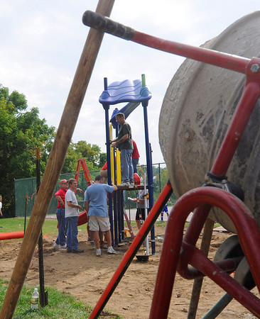 Danvers: The Highlands School and its playground committee have raised $28,000 for a new playground. Members of the Highlands School community built the playground Saturday.  photo by Mark Teiwes / Salem News