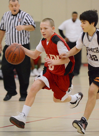 Ipswich: Salem 8th grade travel basketball player Trace Schaejbe dribbles by Ipswich's Zach Elipolis. photo by Mark Teiwes  / Salem News