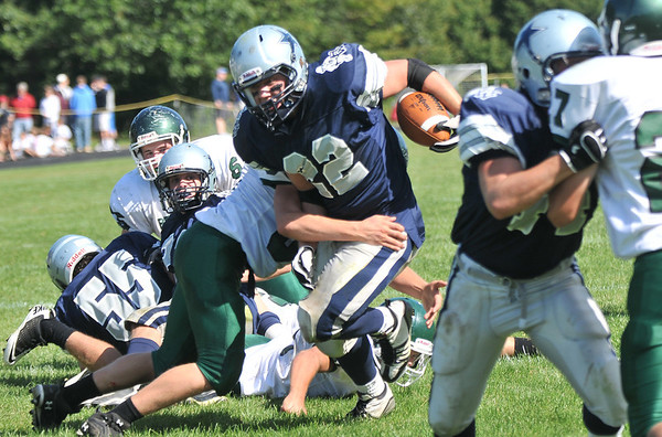 Hamilton: Hamilton-Wenham running back Elliott Burr runs for a first down against Pentucket.   photo by Mark Teiwes  / Salem News