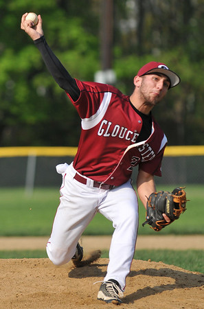 Beverly: Gloucester High School's Joseph Avila releases a fastball during the team's 4-6 loss to Beverly. photo by Mark Teiwes / Salem News