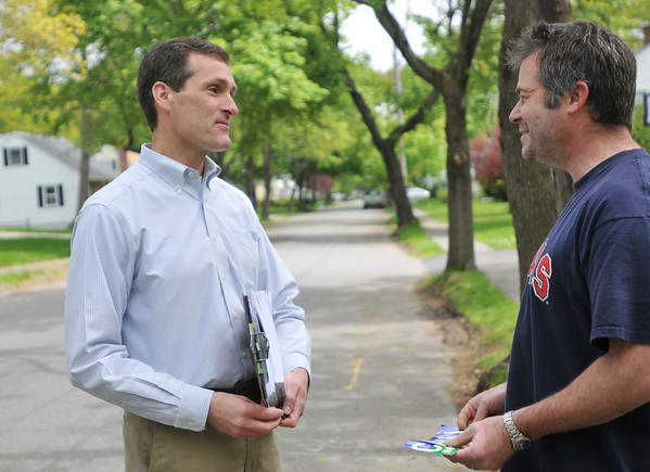 Beverly: Mayoral candidate Mike Cahill, left, campaigns along Foster Street speaking with Philip Thornton.  photo by Mark Teiwes / Salem News