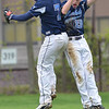 Beverly: Peabody's Nick Allen and Wesley Sanders celebrate the team's win over Beverly yesterday.  photo by Mark Teiwes / Salem News