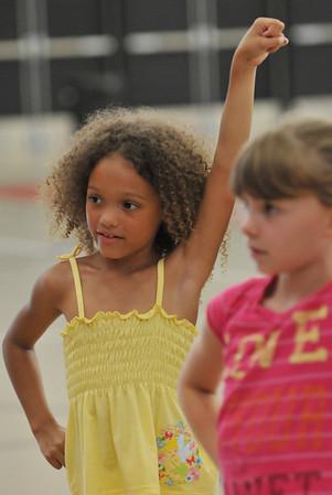 Salem: Tanjelah Lashae, 7, of Salem learns a cheer.  photo by Mark Teiwes / Salem News