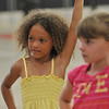 Salem: Tanjelah Lashae, 7, of Salem learns a cheer.  photo by Mark Teiwes / Salem News