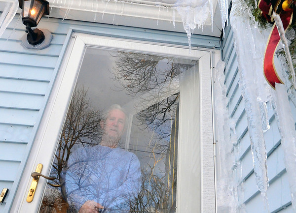 """Peabody: Michael Doherty of Peabody is an active participant in the timebank.  He earns hours by giving rides to the airport, offering use of his truck to help move, and is a member of the orgainization's """"Kitchen Cabinet,"""" a group that helps run timebank.  He has cashed in his hours for electrical work and a walkway made outside his house.    photo by Mark Teiwes  / Salem News"""