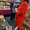 Marblehead: Kera Dalton, dressed in a bright red robe and her son Alex, 11, of Marblehead in pajama pants look for Christmas presents at the Spirit of '76 Bookstore during the annual pajama sale.   photo by Mark Teiwes / Salem News